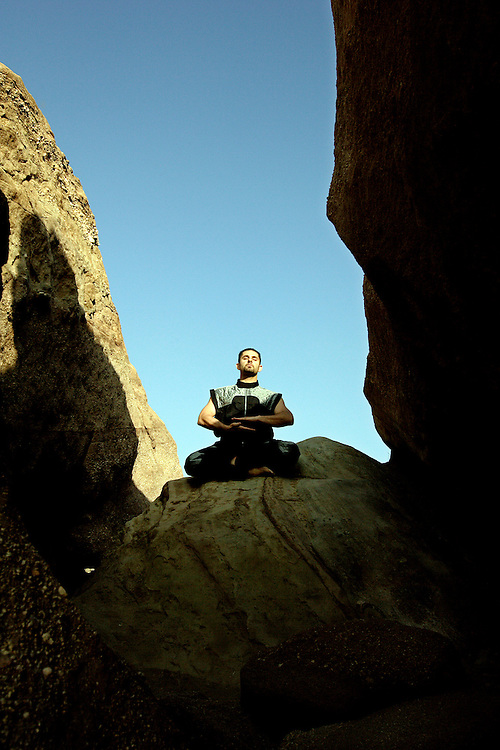 ACTON, CALIFORNIA, March 25, 2007: Shervin Ilbeig meditates on rocks  at Vazquez Rocks in Acton, California. (Photograph by Todd Bigelow/Aurora)