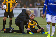 Maidstone United midfielder Michael Phillips (22) receives treatment during the The FA Cup match between Maidstone United and Oldham Athletic at the Gallagher Stadium, Maidstone, United Kingdom on 1 December 2018. Photo by Martin Cole