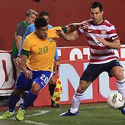 Hulk, Brazil, (left) is challenged by Carlos Bocanegra, USA, during the USA V Brazil International friendly soccer match at FedEx Field, Washington DC, USA. 30th May 2012. Photo Tim Clayton