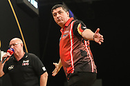 Mensur Suljovic hits a winning double(167) and celebrates during the 2018 Grand Slam of Darts at Aldersley Leisure Village, Wolverhampton, United Kingdom on 16 November 2018. Picture by Shane Healey.