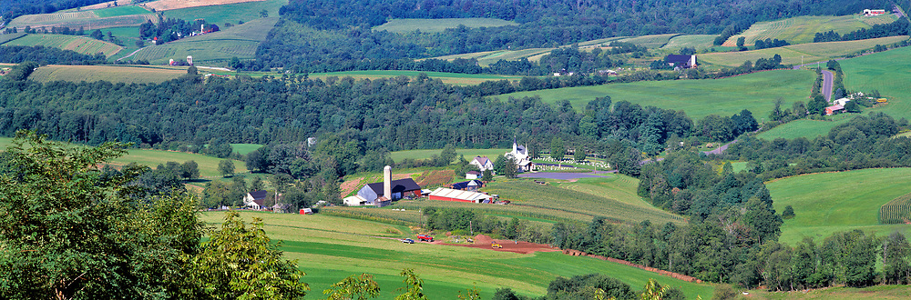 A long, lovely view of the green farms in the Lewisburg area of West Virginia, shows the diversity of uses in this area.