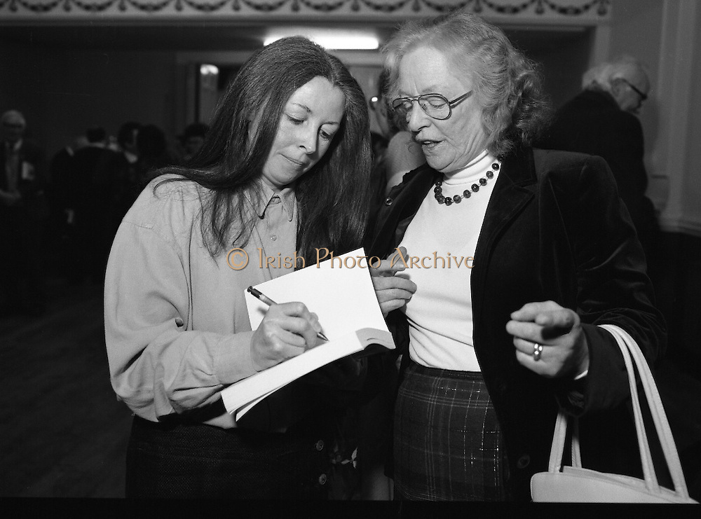 """""""These Obstreperous Lassies"""" Book Launch.  (R93)..1988..15.12.1988..12.15.1988..15th December 1988..A book which chronicles an important aspect of Irish social history was launched in Larkin Hall. """"These Obstreperous Lassies"""" written and researched by Mary Jones, details the seventy three years of the Irish Women Workers Union and of the women who were involved in the union..With Countess Markievicz as its first president, The Union began the fight for equal pay and fair treatment under the leadership of women like helen Chenevix, Louise Bennett and Helena Molloy. They fought for the rights of vulnerable workers such as Laundresses,print workers,box makers,nurses and dressmakers..The Author, Mary Jones, is a full time researcher specialising in Women and Work...Picture shows the Author Mary Jones signing a copy of her book at its launch in Larkin Hall, Parnell Square."""