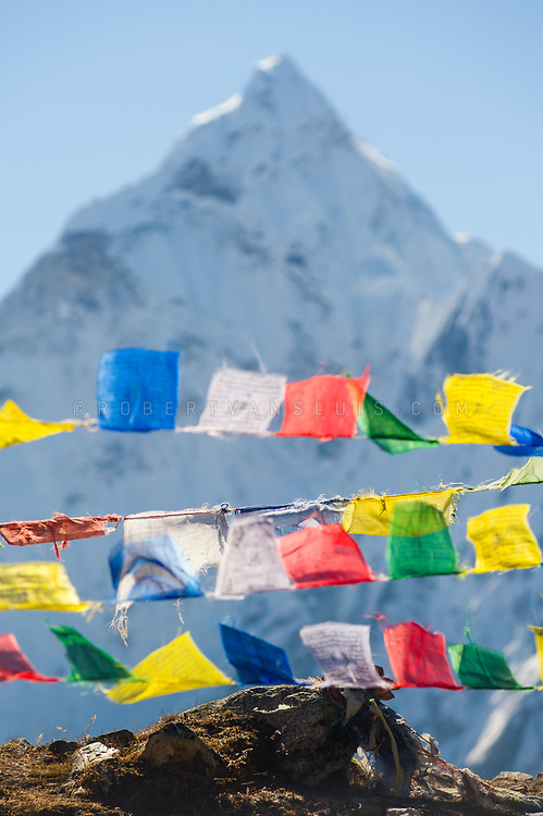 Prayer flags with Ama Dablam (6856 m), in the Nepal Himalaya. Photo © robertvansluis.com