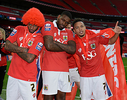 Bristol City's Mark Little, Bristol City's Jay Emmanuel-Thomas and Bristol City's Korey Smith celebrate the win against Walsall in the Johnstone Paint Trophy final - Photo mandatory by-line: Dougie Allward/JMP - Mobile: 07966 386802 - 22/03/2015 - SPORT - Football - London - Wembley Stadium - Bristol City v Walsall - Johnstone Paint Trophy Final