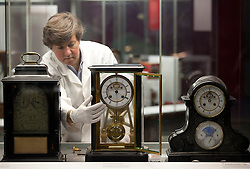 © Licensed to London News Pictures. 26/10/2012. London, UK. Richard Horton, a Science Museum Conservator, poses with a French table clock from the 1800's as the museum prepares to put its clocks back by an hour with the rest of the Britain this Sunday (28/10/12). Photo credit: Matt Cetti-Roberts/LNP