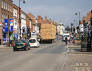 Traffic including trailer carrying straw in the High Street, Newmarket, Suffolk, England
