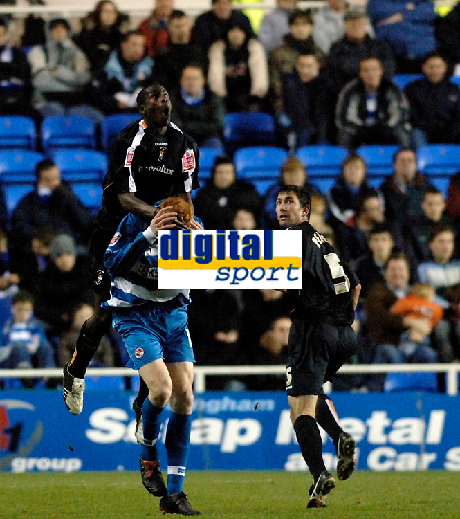 Photo: Daniel Hambury.<br />Reading v Luton Town. Coca Cola Championship.<br />03/12/2005.<br />Reading's Dave Kitson (bottom) is fouled by Luton's Leon Barnett. The resulting free kick lead to Reading's second goal.