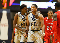 Feb 26, 2018; Morgantown, WV, USA; West Virginia Mountaineers forward Wesley Harris (21) talks with West Virginia Mountaineers forward Sagaba Konate (50) during the second half against the Texas Tech Red Raiders at WVU Coliseum. Mandatory Credit: Ben Queen-USA TODAY Sports