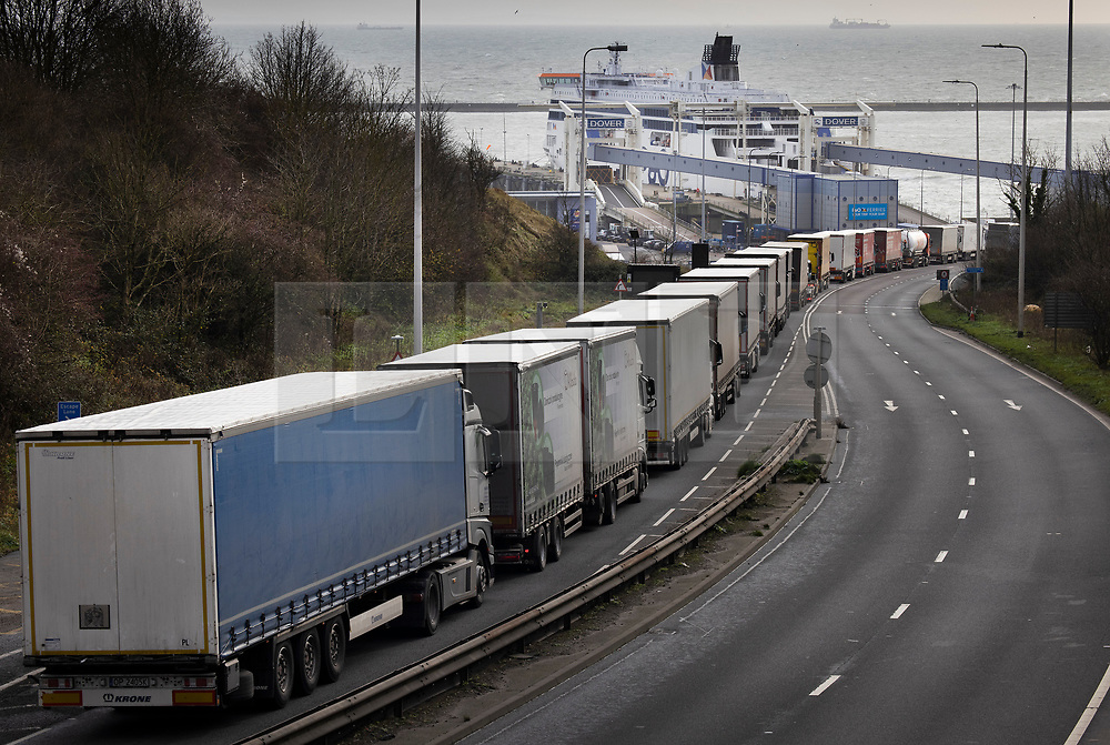 © Licensed to London News Pictures. 18/12/2020. Dover, UK. Trucks queue up on the A2 to enter the Port of Dover. Retailers are suggesting that delays at some ports are causing shortages of goods in the shops this Christmas. Photo credit: Peter Macdiarmid/LNP