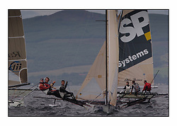 The 2004 Skiff Nationals at Largs held by the SSI.<br /> <br /> Hermes helmed by Grant Rollerson crosses SP Systems helemd by Richard Hall.<br /> <br /> Marc Turner / PFM Pictures
