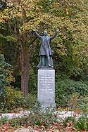 """Lord Stanley statue near the entrance of Stanley Park in Vancouver, British Columbia.  The statue was unveiled in 1960. Lord Stanley of Preston quote on pillar: """"To the use and enjoyment of people of all colours creeds and customs for all time. I name thee Stanley Park."""""""