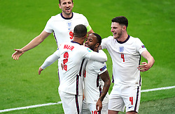 England's Raheem Sterling (centre) celebrates scoring their side's first goal of the game with Kyle Walker (left), Harry Kane and Declan Rice (right) during the UEFA Euro 2020 Group D match at Wembley Stadium, London. Picture date: Tuesday June 22, 2021.