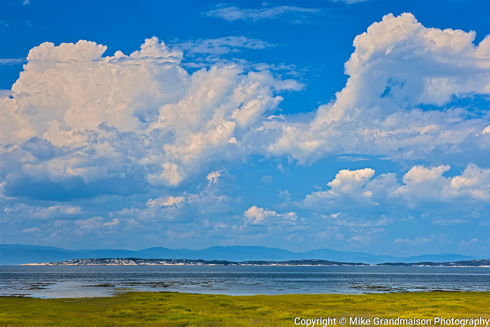 CLouds and the St. Lawrence River<br />Saint-André de Kamouraska<br />Quebec<br />Canada