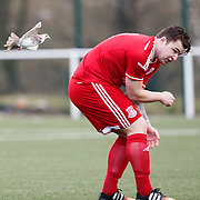Glenafton Athletic player Jamie Hay has a close encounter with a dove at New Tinto Park, Glasgow during the West of Scotland Cup match versus Glenafton. Picture Robert Perry 27th Feb 20<br /> <br /> Please credit photo to Robert Perry<br /> <br /> FEE PAYABLE FOR REPRO USE<br /> FEE PAYABLE FOR ALL INTERNET USE<br /> www.robertperry.co.uk<br /> NB -This image is not to be distributed without the prior consent of the copyright holder.<br /> in using this image you agree to abide by terms and conditions as stated in this caption.<br /> All monies payable to Robert Perry<br /> <br /> (PLEASE DO NOT REMOVE THIS CAPTION)<br /> This image is intended for Editorial use (e.g. news). Any commercial or promotional use requires additional clearance. <br /> <br /> Copyright 2016 All rights protected.<br /> first use only<br /> contact details<br /> Robert Perry     <br /> 07702 631 477<br /> robertperryphotos@gmail.com<br />   <br /> Robert Perry reserves the right to pursue unauthorised use of this image . If you violate my intellectual property you may be liable for  damages, loss of income, and profits you derive from the use of this image.