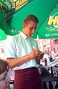 Waiter age 23 taking order at outside sidewalk cafe.  Warsaw Poland