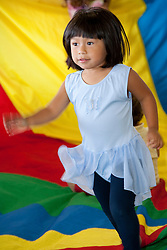 United States, San Francisco, girl (age 3) running in gymnastics class.  MR