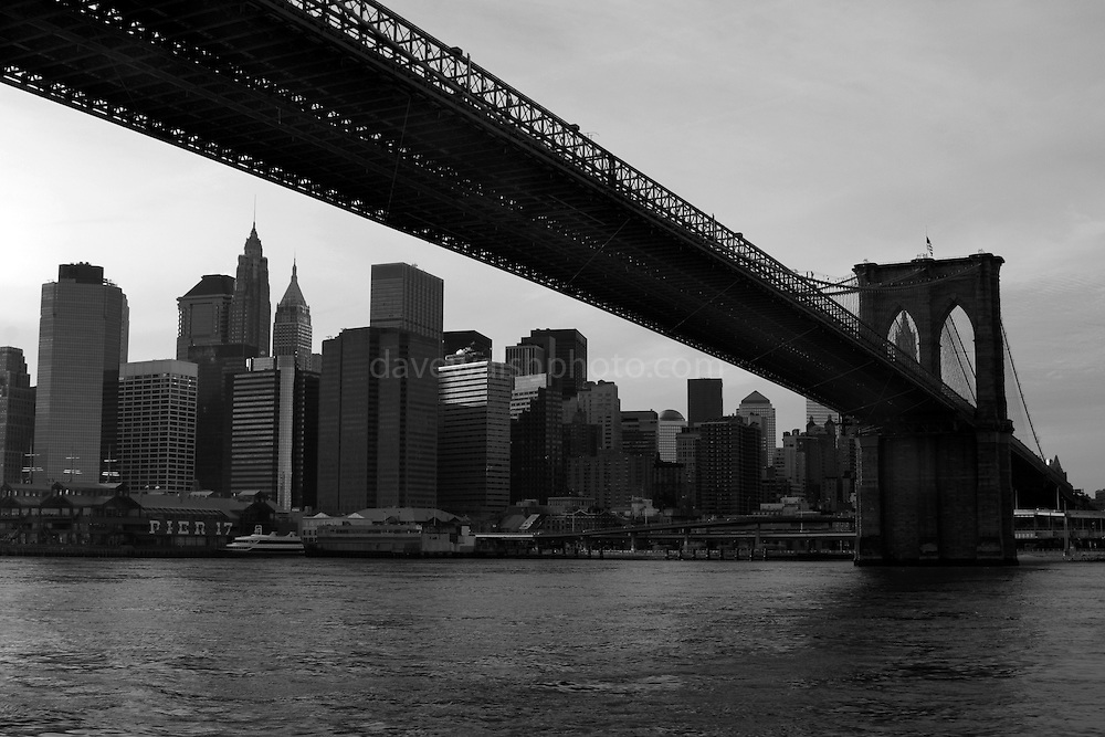 """The Brooklyn Bridge, photographed from a water taxi This mage can be licensed via Millennium Images. Contact me for more details, or email mail@milim.com For prints, contact me, or click """"add to cart"""" to some standard print options."""