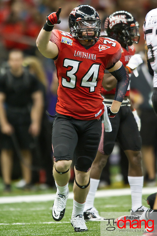 Louisiana-Lafayette's Justin Anderson DE (34) celebrates after a tackle during the R+L Carriers New Orleans Bowl at the Mercedes-Benz Superdome.  Louisiana-Lafayette defeated San-Diego State 32-30. (Copyright Michael Chang)