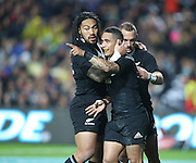 Aaron Smith of the All Blacks celebrates his second try with Ma'a Nonu of the All Blacks , left, and Aaron Cruden of the All Blacks right, during the third rugby test between the All Blacks and England played at Waikato Stadium in Hamilton during the Steinlager Series - All Blacks v England, Hamiton, 21 June 2014<br /> www.photosport.co.nz