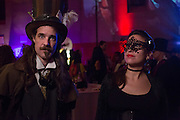 A man costumed as the Mad Hatter and a woman not costumed as Alice.