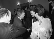 U2 Meet An Taoiseach, Charles Haughey.    (R58)..1987..18.05.1987..05.18.1987..18th May 1987..After their highly successful tour of America, An Taoiseach, Charles Haughey welcomed U2 back to Ireland with a reception held in Iveagh House, Dublin. Iveagh House formerly a home to the Guinness family is now held by the Department of Foreign Affairs...Image shows An Taoiseach,Charles Haughey, greeting Bono (Paul Hewson) on his visit to Iveagh House. Paul McGuinness,U2 manager,and Mrs Maureen Haughey are included in the image.
