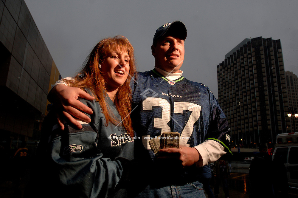 """""""We've been waiting 22 years to see the Seahawks win the Super Bowl We went to the championship game in Seattle last week, but this trip will be far more expensive!"""" ..Seahawks fans, Jennifer Roux and Scott Otoole, of Boston, Massachusetts, are willing to spend up to $3,000 in cash, each,  for Super Bowl tickets.   (Robert Caplin For The New York Times).."""