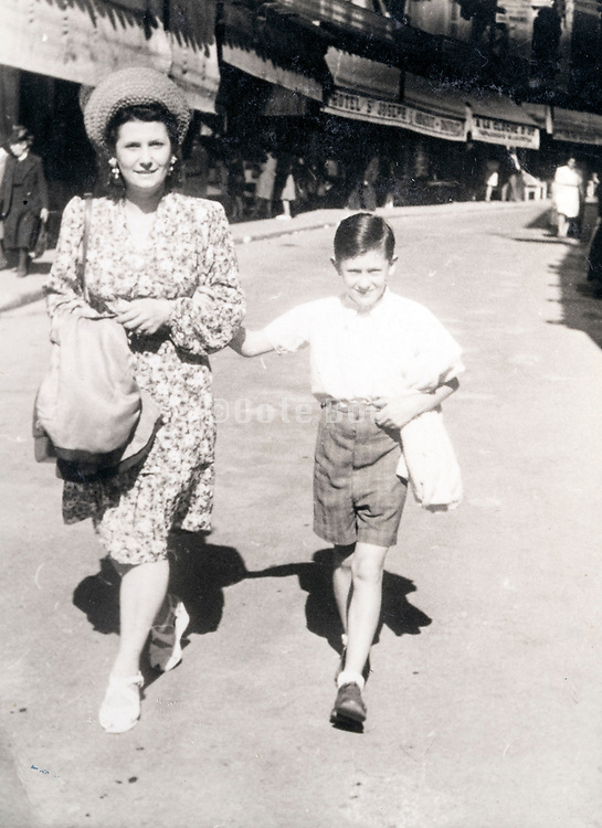 mother walking with son France ca 1950s