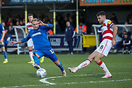 AFC Wimbledon midfielder Mitchell (Mitch) Pinnock (11) battles for possession with Doncaster Rovers midfielder Ben Whiteman (8) during the EFL Sky Bet League 1 match between AFC Wimbledon and Doncaster Rovers at the Cherry Red Records Stadium, Kingston, England on 14 December 2019.