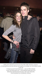 MISS LEAH WOOD and her brother MR JESSE WOOD children of Rolling Stone Ronnie Wood, at a party in London on 21st March 2002.	OYO 34