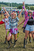 A couple who have just got engaged celebrate with their friends - The 2016 Glastonbury Festival, Worthy Farm, Glastonbury.