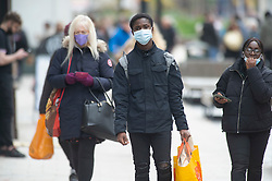 © Licensed to London News Pictures 20/05/2021. Bromley, UK. Shoppers wearing masks to protect themselves while enjoying some new found freedom in Bromley High Street, South East London today. Coronavirus infection rates are up in three South East London Boroughs. Greenwich, Lewisham and Bromley have seen an increase.  Photo credit:Grant Falvey/LNP