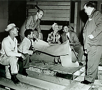 1942 (L to R) Forrest Cooper, Jules Stein, Al Ybarra, Bette Davis & John Garfield planning the construction of the Hollywood Canteen