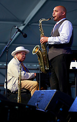 05 May 2013. New Orleans, Louisiana,  USA. <br /> New Orleans Jazz and Heritage Festival. JazzFest.<br /> Legendary Jazz pianist Ellis Marsalis and son Branford play the Jazz tent.<br /> Ellis Marsalis passed away April 1st 2020 of complications associated with Coronavirus - COVID-19.<br /> Photo ©; Charlie Varley/varleypix.com