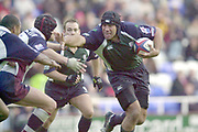 Reading, Berkshire, UK., 26th October 2003, Zurich Premiership Rugby, Madejski Stadium, England, [Mandatory Credit: Peter Spurrier/Intersport Images],<br />  <br /> <br /> 2003_04 Zurich Premiership Rugby - London Irish v Rotherham<br /> London Irish No. 8 Chris Sheasby look's to hand off the Rotherham defence as he breaks from the back off the scrum.