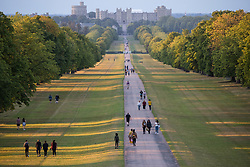 Windsor, UK. 21 July, 2020. Local residents enjoy some socially-distanced exercise on the Long Walk in Windsor Great Park in view of Windsor Castle.