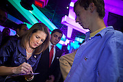 """11 DECEMBER 2011 - SCOTTSDALE, AZ:    Congresswoman and Republican Presidential hopeful MICHELE BACHMANN (R-MN) signs autographs for a supporter at a fundraiser sponsored by Politics on the Rocks at the Mint in Scottsdale, Sunday. The Mint is a popular bar and restaurant built in a former bank in Scottsdale, AZ. Politics on the Rocks was started by Charles A. Jensen in Scottsdale, Arizona. The purpose of """"Politics on the Rocks"""" is to bring Republican & Conservative Professionals together in a monthly happy hour where they can network, socialize, and hear directly from prominent politicians and successful business leaders.     PHOTO BY JACK KURTZ"""