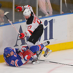 May 16, 2012: New Jersey Devils left wing Ilya Kovalchuk (17) checks New York Rangers left wing Ruslan Fedotenko (26) to the ice during first period action in game 2 of the NHL Eastern Conference Finals between the New Jersey Devils and New York Rangers at Madison Square Garden in New York, N.Y.