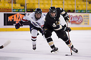 October 13, 2007 - Anchorage, Alaska:  Ryan Cruthers (16) of the Robert Morris Colonials chases after Tylor Michel (16) of the Wayne State Warriors in the Colonials 4-1 win over Wayne State in the 3rd game of the Nye Frontier Classic at the Sullivan Arena.  RMU would go on to be the Classic Champions after host Alaska-Anchorage tied with Boston University in the 4th game of the Classic.