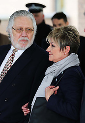Dave Lee Travis looks at his his wife Marianne Griffin outside Southwark Crown Court in London after he was cleared of 12 out of 14 charges, Thursday, 13th February 2014. Picture by Stephen Lock / i-Images