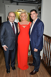 Left to right, SIR SALMAN RUSHDIE, NATALIE COYLE and ZAFAR RUSHDIE at a party to celebrate the engagement of Natalie Coyle and Zafar Rushdie held at Library, St.Martin's Lane, London on 6th September 2014.