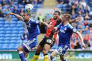 Cardiff City's Lee Peltier (l) and Craig Noone (r) challenge Birmingham's David Davis (c). Skybet football league championship match, Cardiff city v Birmingham city at the Cardiff city stadium in Cardiff, South Wales on Saturday 7th May 2016.<br /> pic by Carl Robertson, Andrew Orchard sports photography.