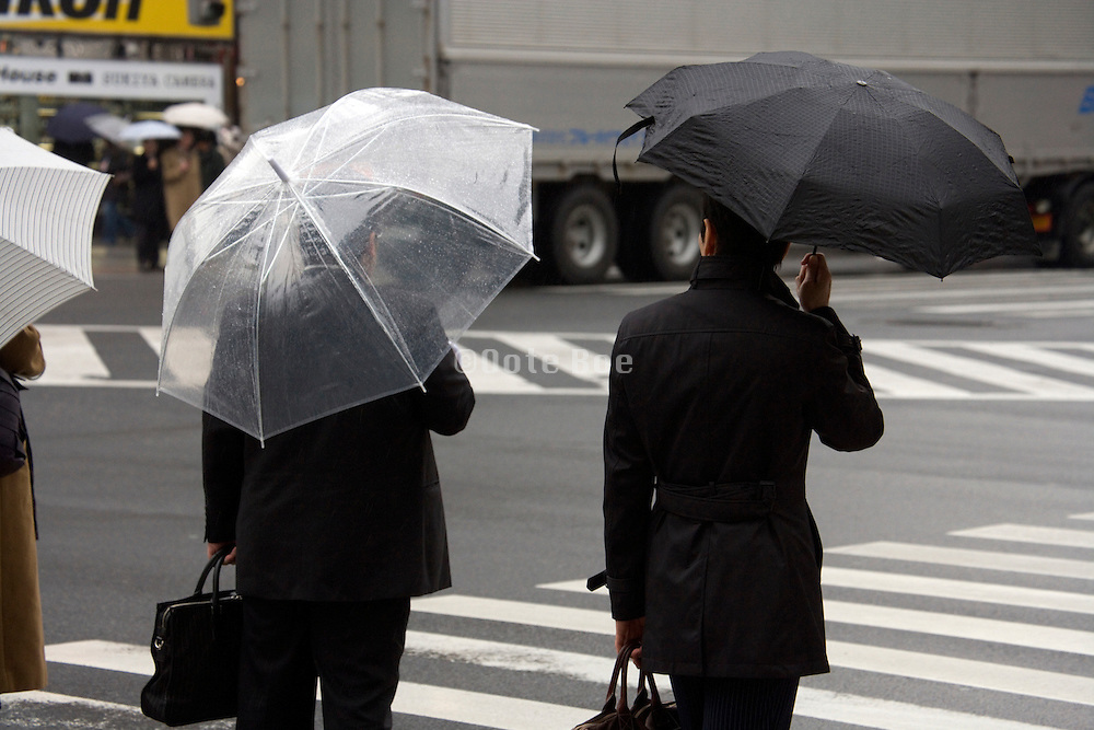 businessman in Tokyo with the traditional cheap transparent plastic umbrella