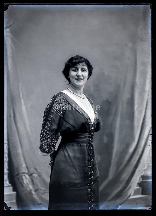 smiling self assured adult woman studio portrait France ca 1920s