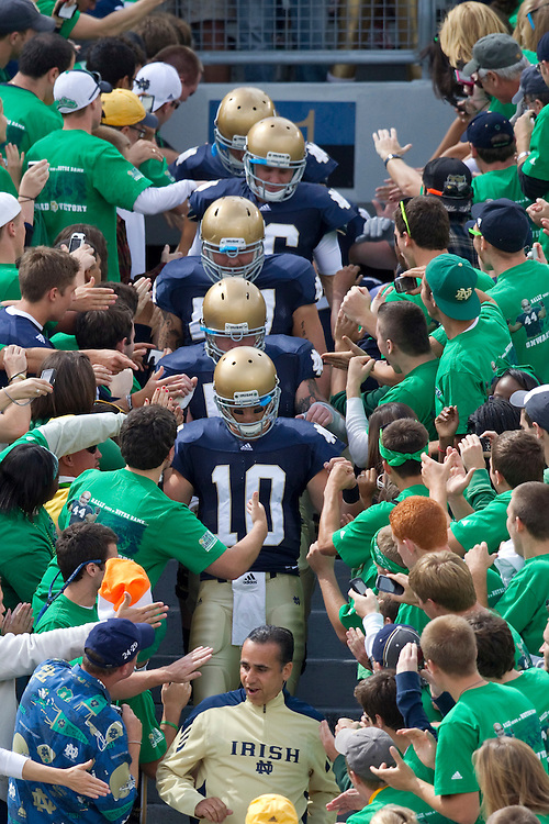 Notre Dame players pass through the student section for pregame warmups in game action during NCAA football game between the Notre Dame Fighting Irish and the Purdue Boilermakers.  Notre Dame defeated Purdue 23-12 in game at Notre Dame Stadium in South Bend, Indiana.