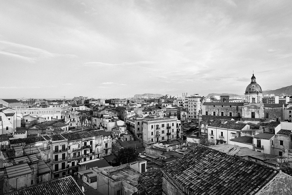 PALERMO, ITALY - 17 JANUARY 2019: A view of Palermo from the historic market of Ballarò, in Palermo, Italy, on January 17th 2019.<br /> <br /> The historic market Ballarò of Palermo, in the neighbourhood known as Albergheria, is the oldest and biggest among the markets of the city.<br /> For about half a century, after World War II, Ballarò was increasingly depopulated as families moved to airier suburbs. Today there are over 14 ethnicities in Ballarò and more than 25 languages spoken: migrant communities, students, professionals, historic merchants and new entrepreneurs coexist.