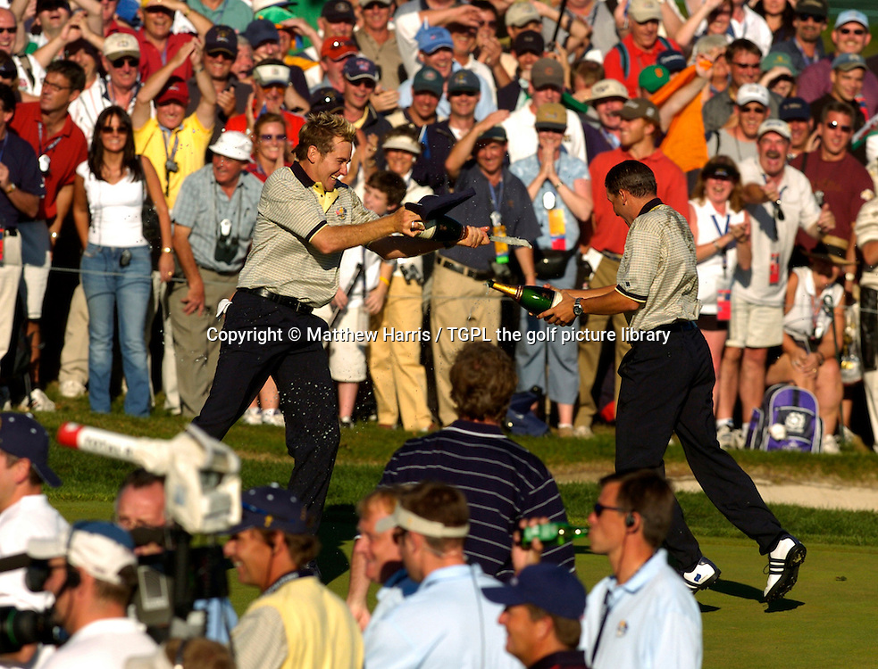 Celebrations for Ian POULTER (EUR) and Sergio GARCIA (EUR) as they spray champagne over each other during final day Singles of the Ryder Cup Matches 2004,Oakland Hills (South Course),Bloomfield,Michigan,USA.