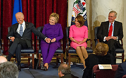 From left to right: United States Vice President Joe Biden, former US Secretary of State Hillary Clinton, US House Minority Leader Nancy Pelosi (Democrat of California) and US Senate Majority Leader Mitch McConnell (Republican of Kentucky) react during the ceremony where the official portrait of US Senate Minority Leader Harry Reid (Democrat of Nevada) is to be unveiled in the Kennedy Caucus Room on Capitol Hill in Washington, DC, USA, on Thursday December 8, 2016. Photo by Ron Sachs/CNP/ABACAPRESS.COM