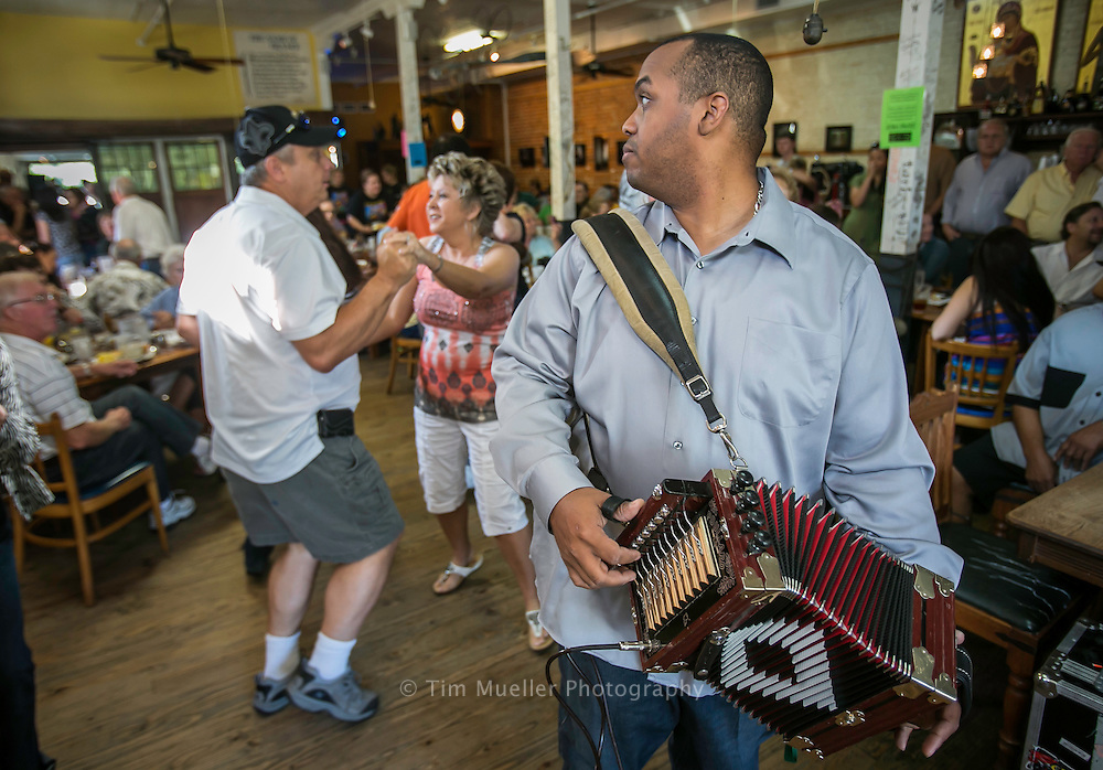 Corey Ledet, right, and his Zydeco band perform Saturday morning during the Cafe Des Amis Zydeco Breakfast in Breaux Bridge, Louisiana.