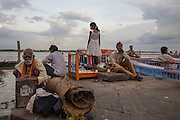 Young girl and men at Dashashwamedh Gath near Ganges River in Varanasi, India.