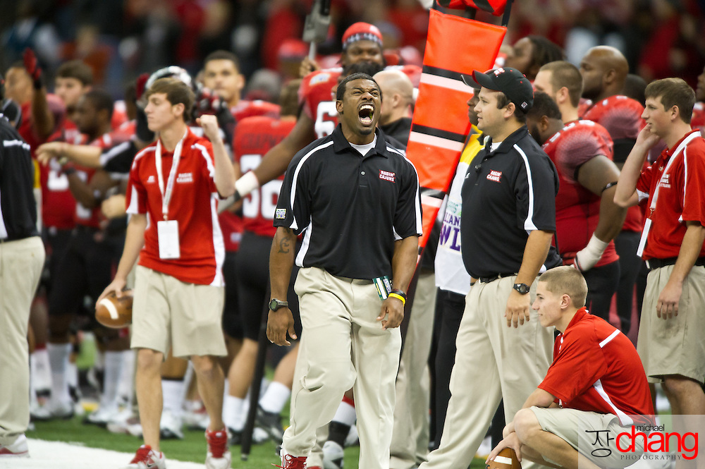 Louisiana-Lafayette's strength and conditioning coach, Derik Keye reacts to a first down play during the R+L Carriers New Orleans Bowl at the Mercedes-Benz Superdome.  Louisiana-Lafayette defeated San-Diego State 32-30. (Copyright Michael Chang)